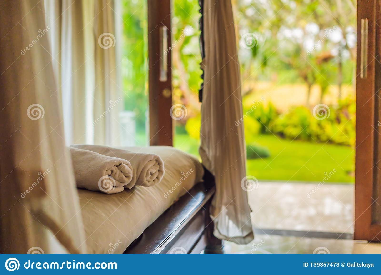 Beautiful room in villa, towel on the bed