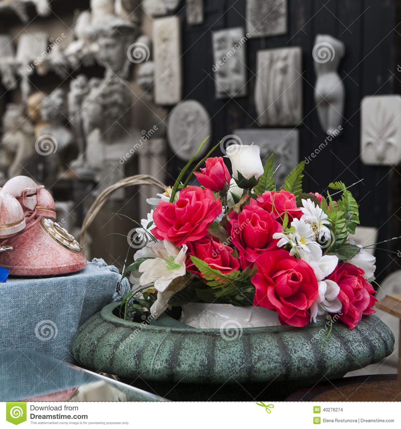 Beautiful Rose Of Artificial Flowers And Old Pink Phone With Disk