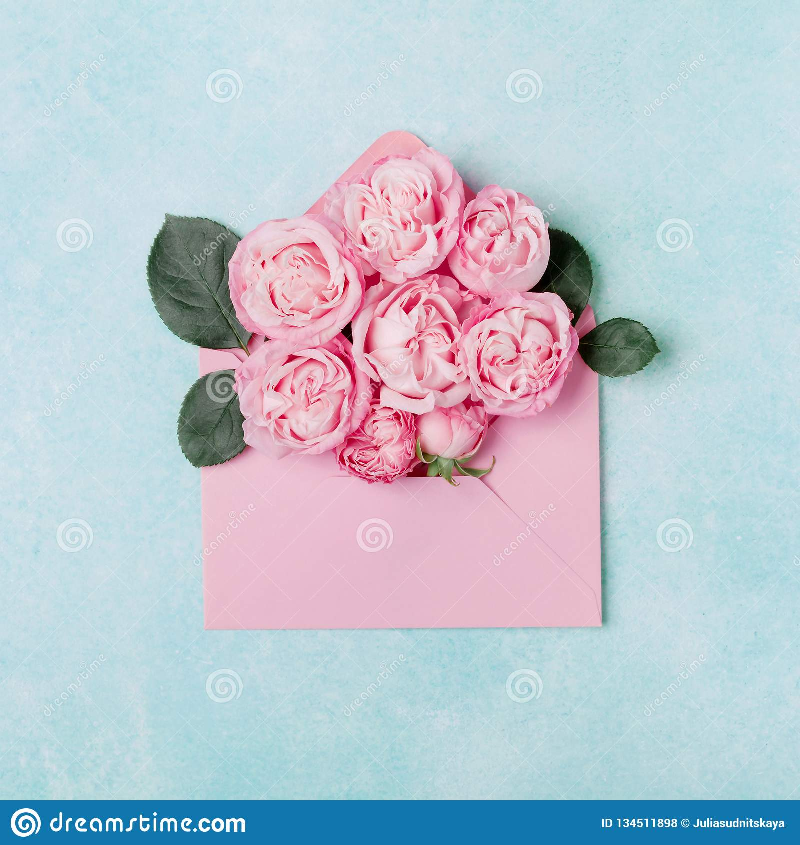 Beautiful Rose Flowers In The Envelope On Blue Background