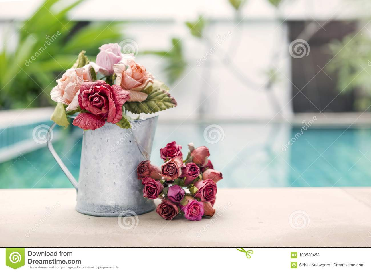 Beautiful Rose Paper Flower In Water Tin Pot Over Blurred Swimming