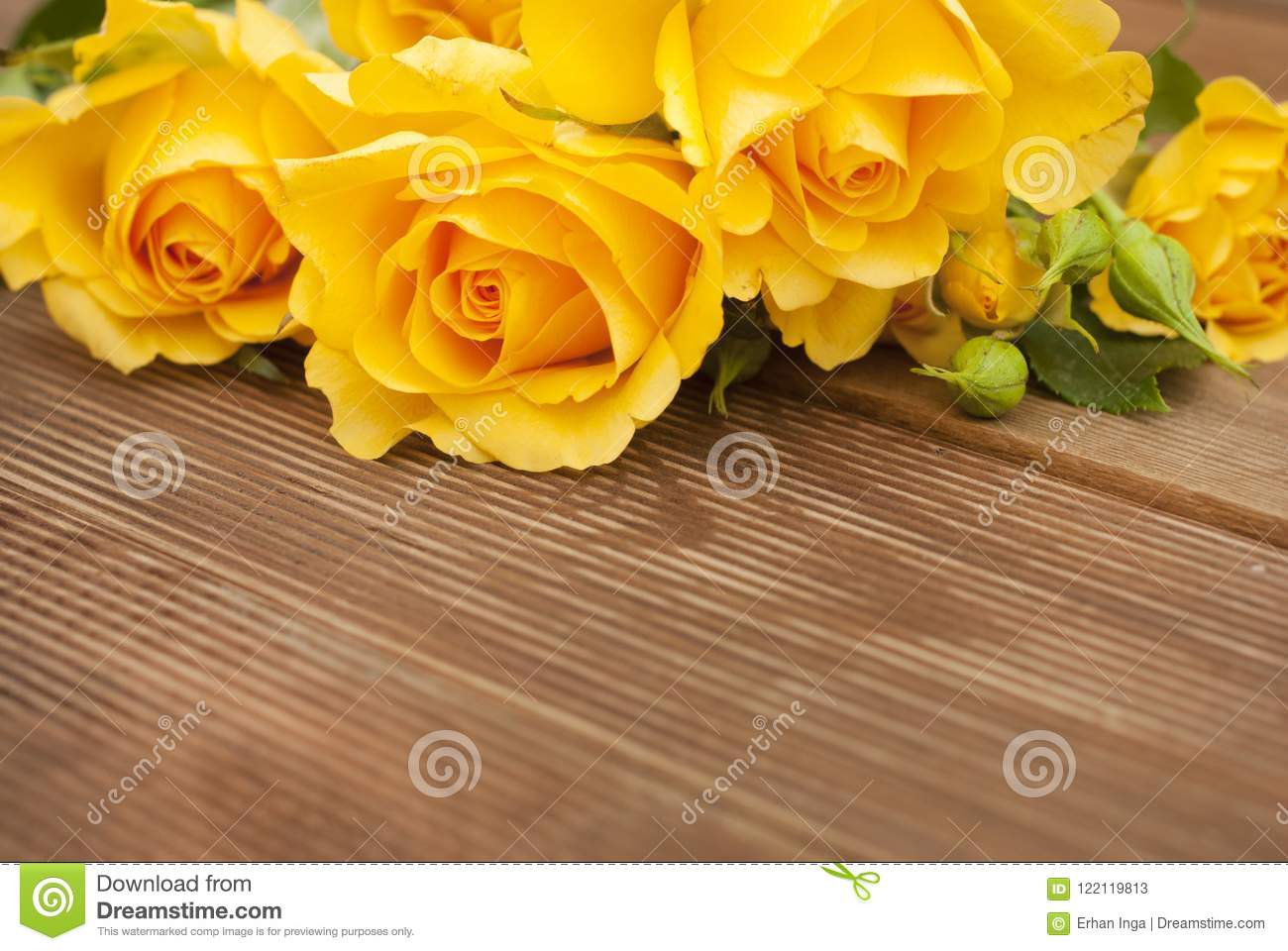 Beautiful Roses Bouquet over Wooden Table. Copy Space. Vintage yeelow flowers.