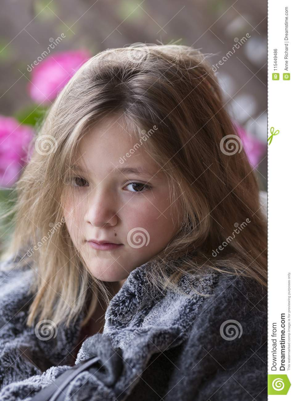 Beautiful Round Faced Pink Cheeked Little Girl With Dishevelled