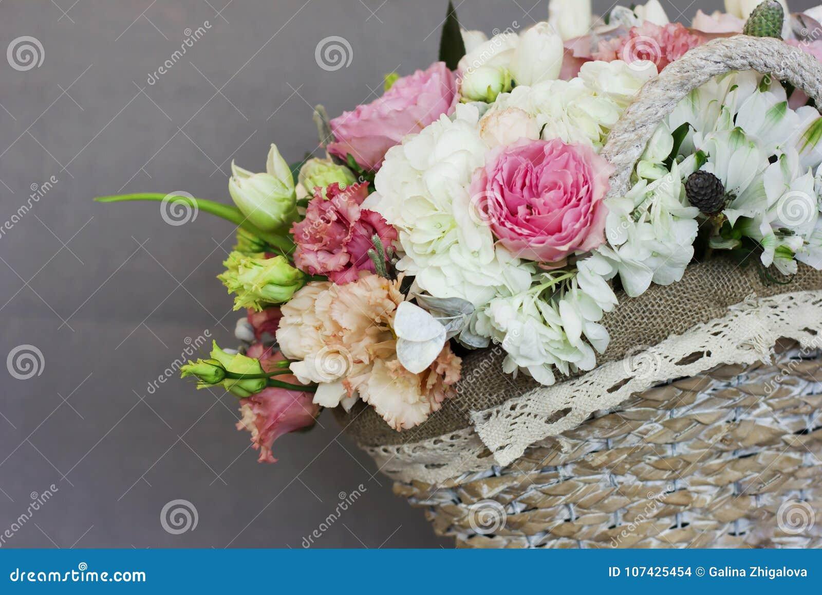 The Beautiful Rustic Bouquet Of Flowers In Wicker Basket Stock Photo ...