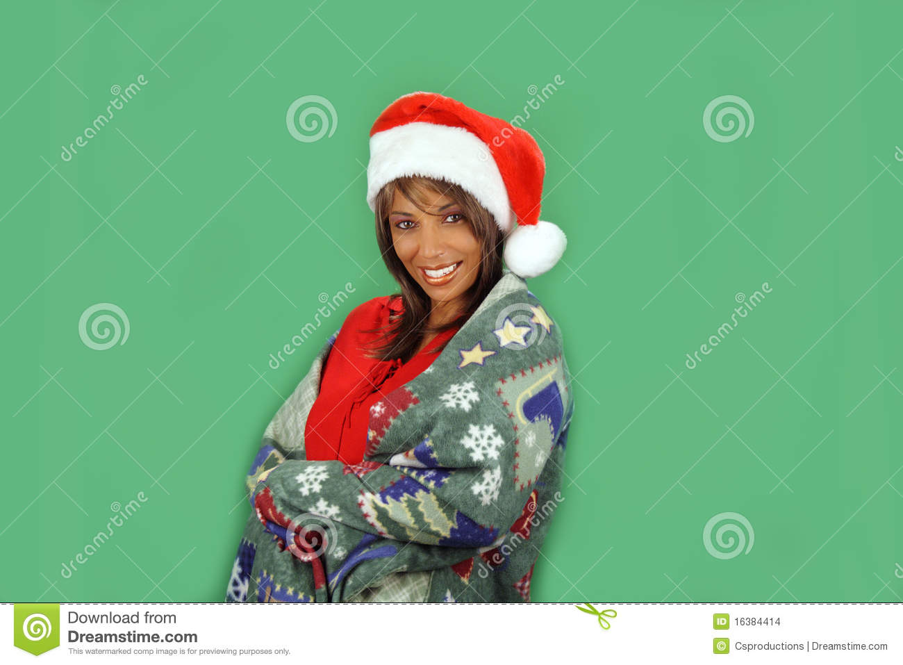 Mature black woman with a bright warm smile and wearing a santa