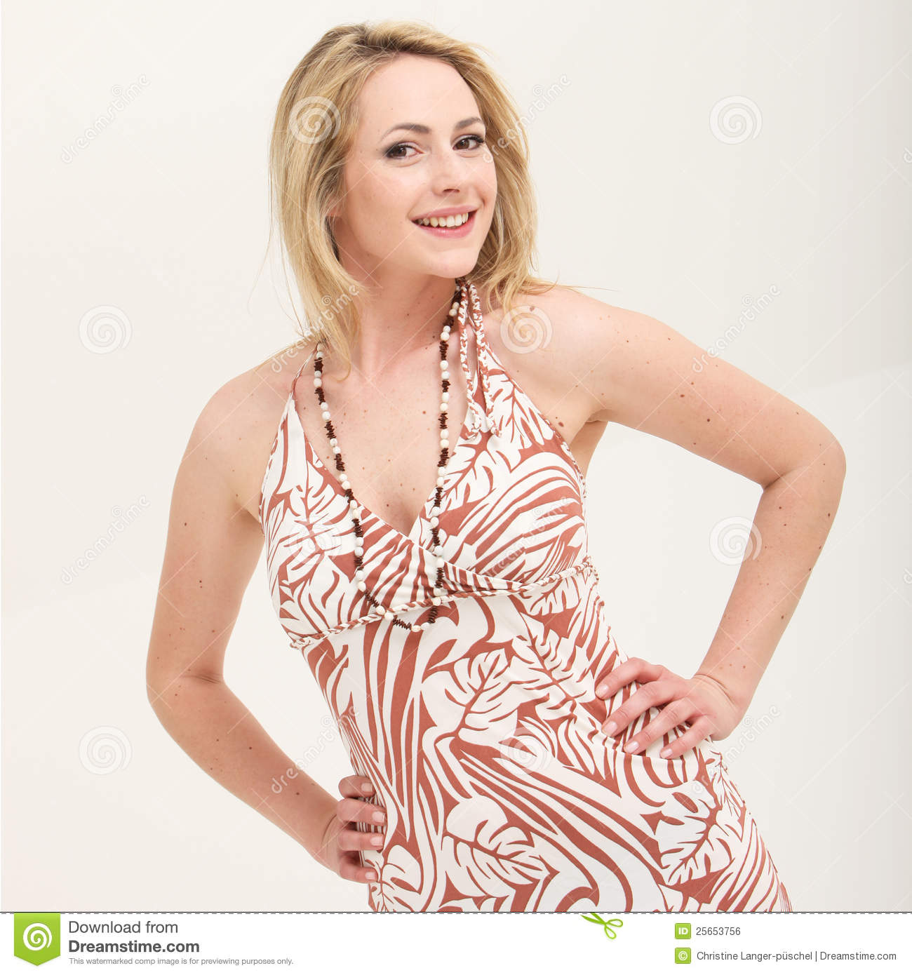 Beautiful sassy young woman with a lovely smile standing akimbo with    Sassy White Woman