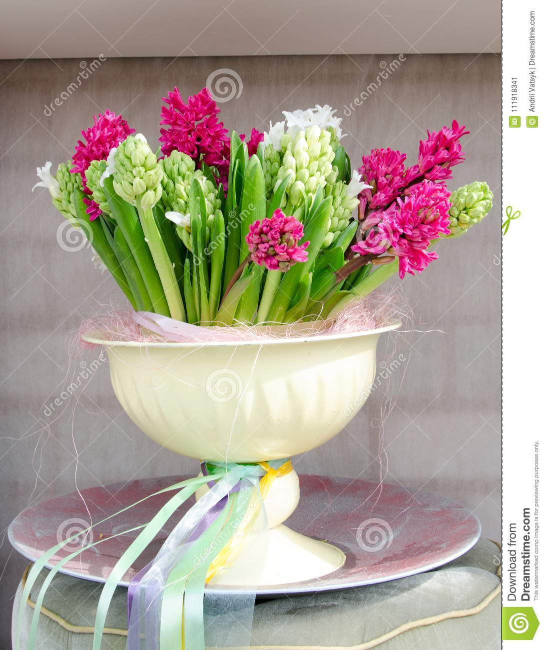 Beautiful scenery with flowers in a bowl in a niche on the wall download beautiful scenery with flowers in a bowl in a niche on the wall stock image izmirmasajfo