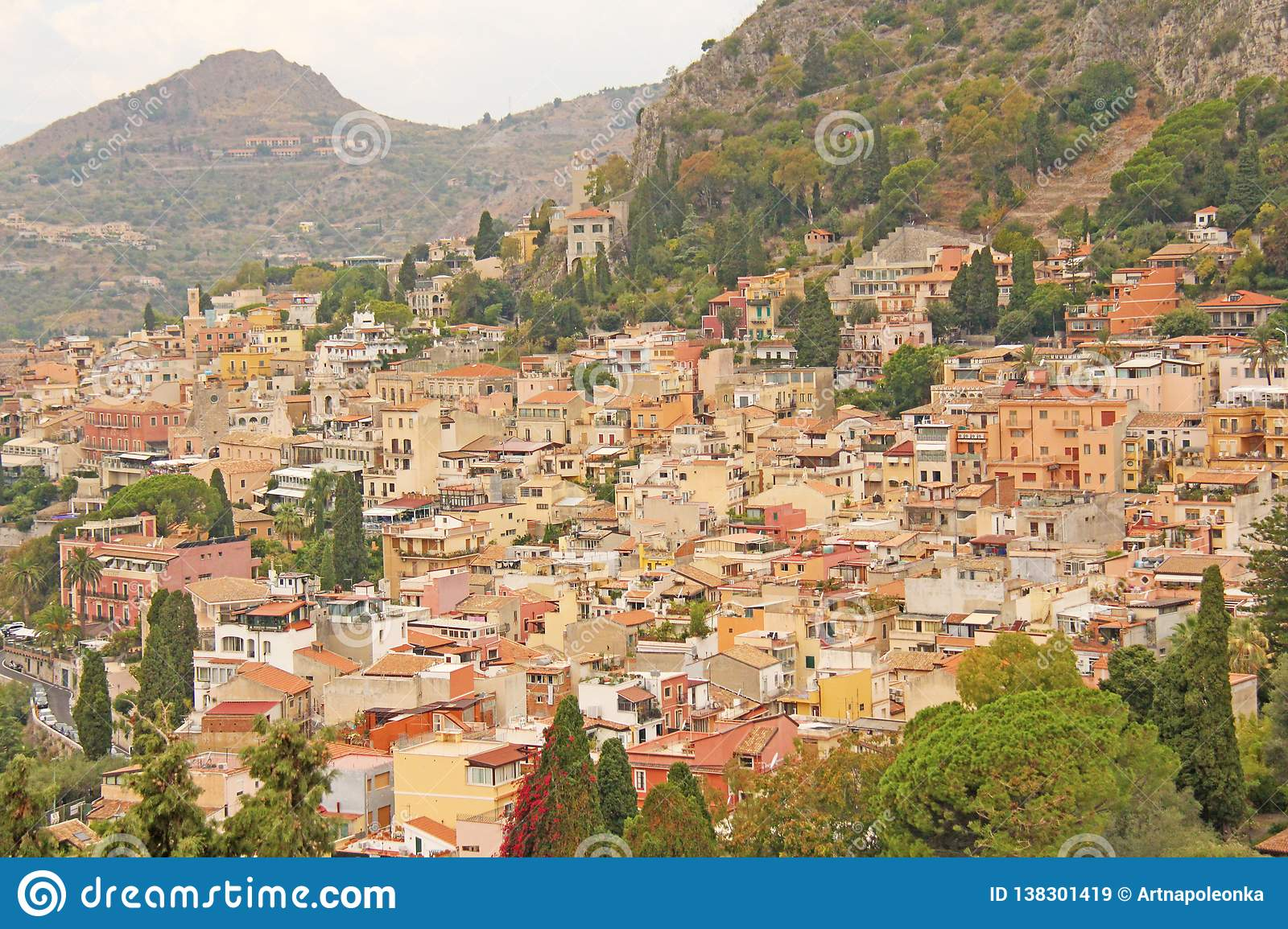 Beautiful Scenic View of Taormina`s Old Town. Terracotta Old Ancient City Houses with Tiled Roofs. The island of Sicily, Italy