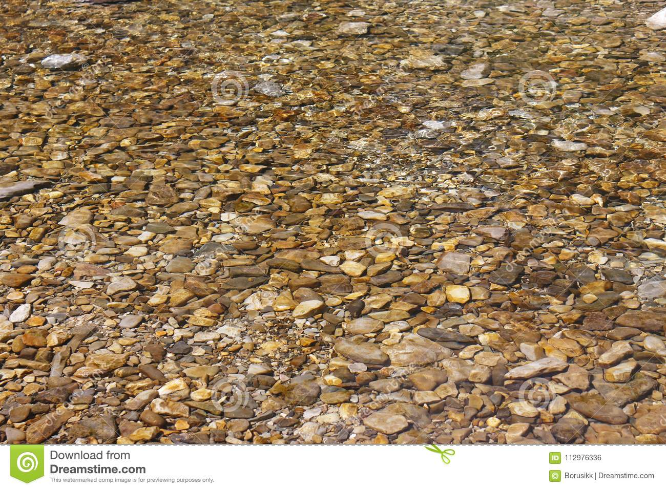 Beautiful sea pebbles under water on beach