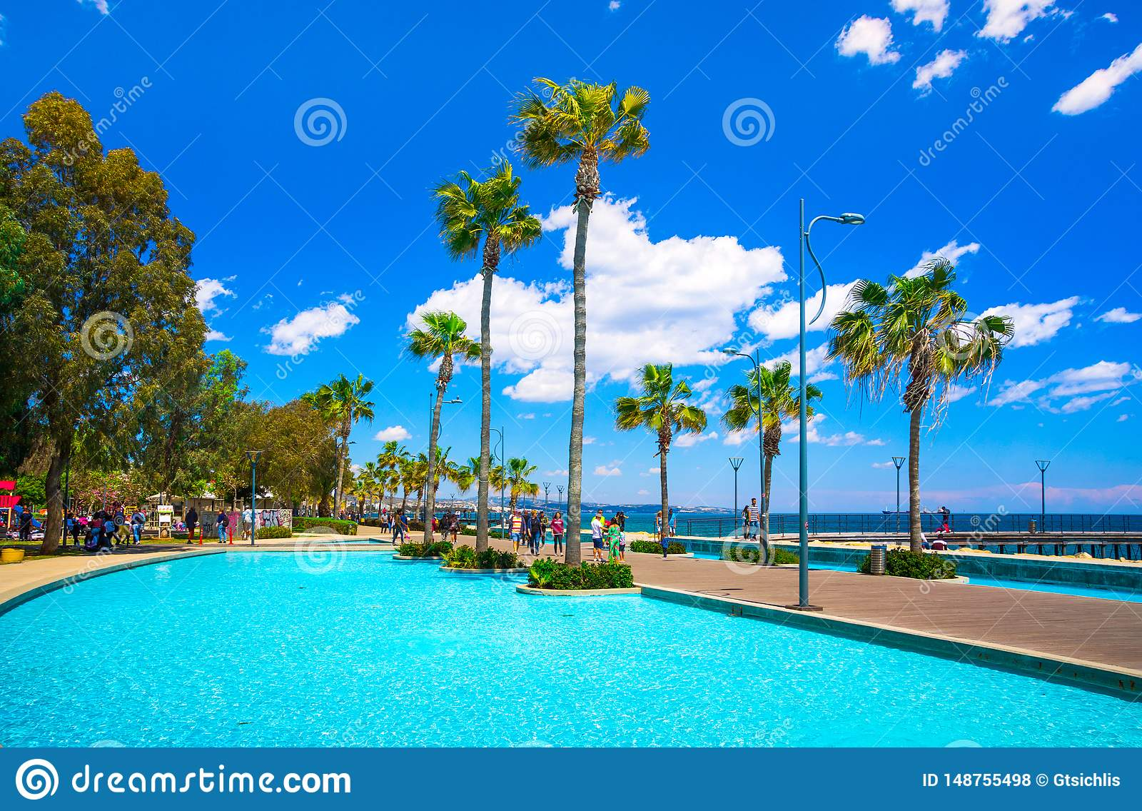 Beautiful sea promenade with palms, sculptures and pools in Limassol, Cyprus