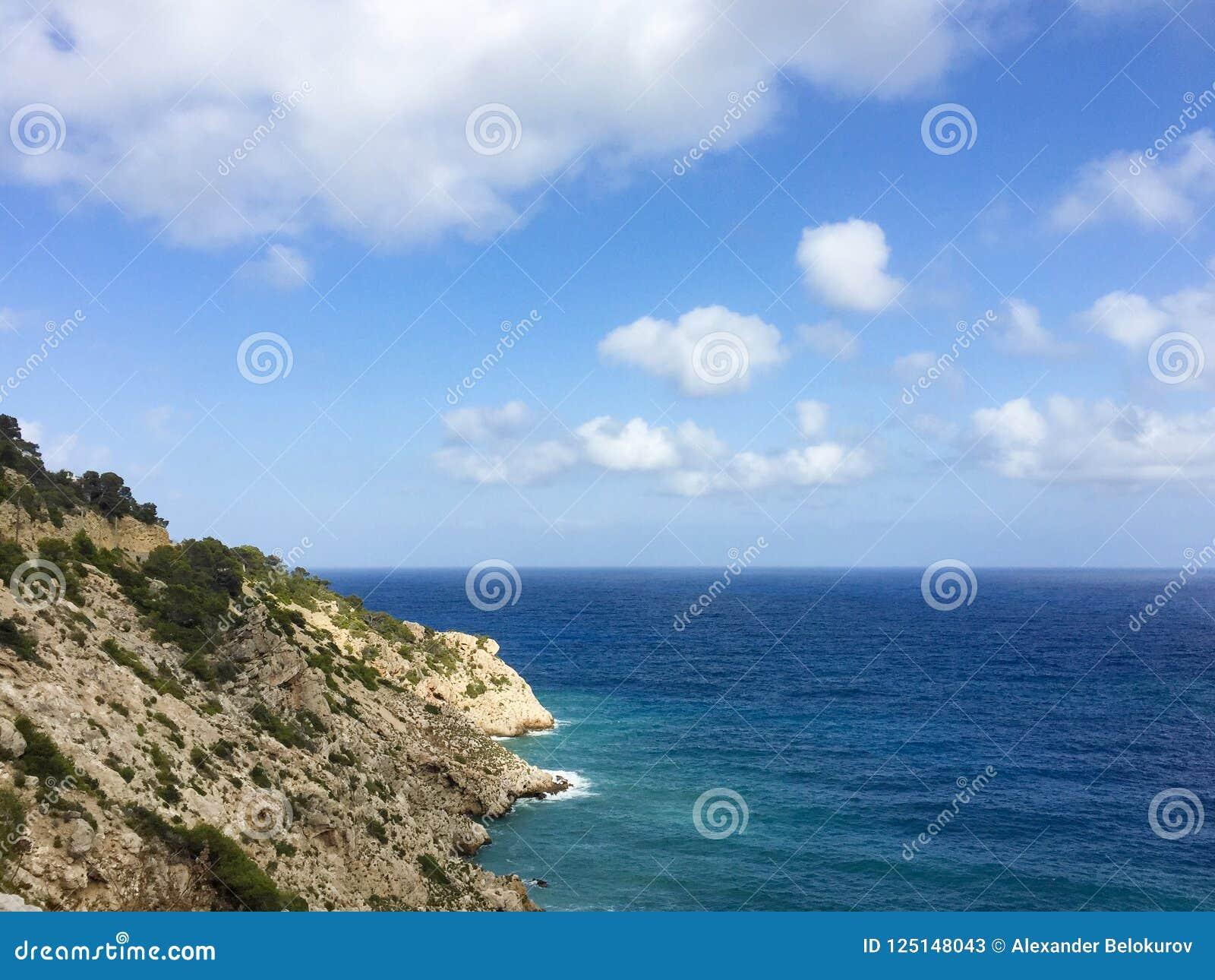 Beautiful Sea And Rocks Vew Over Horizon In Cala Llonga Bay