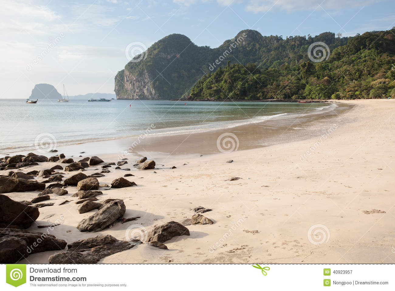 Beautiful seascape beach in Thailand with the long tail in backgroud.