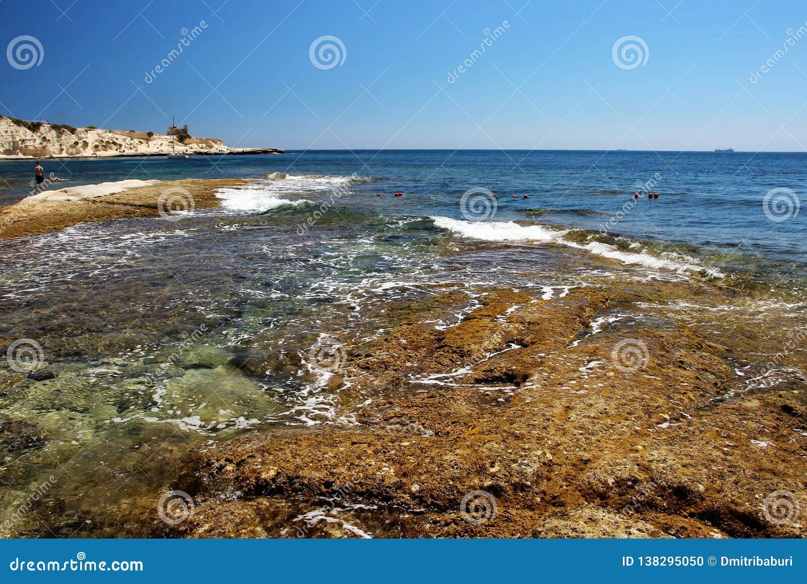 Beautiful seascape, rocky Maltese beach view.