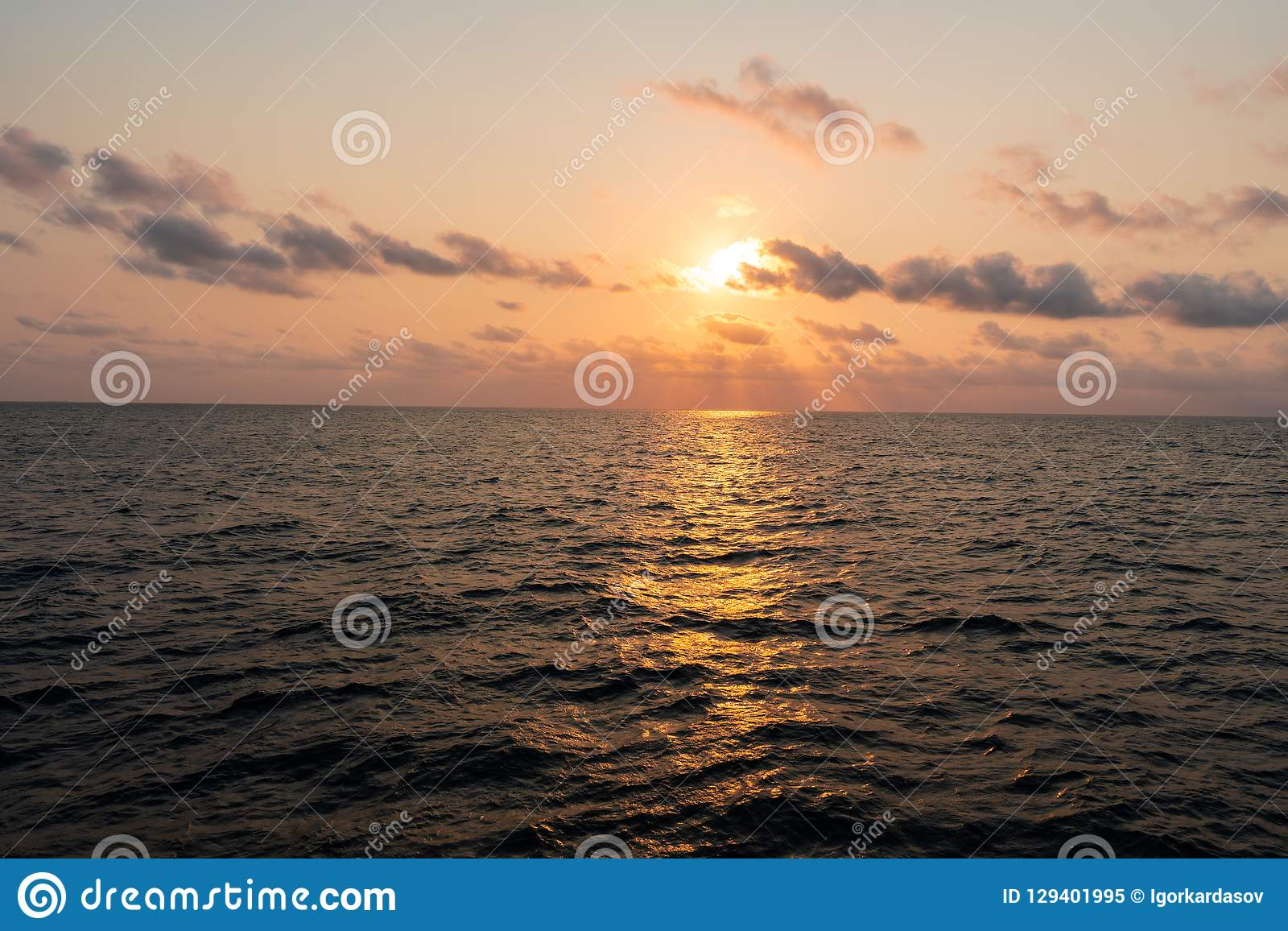 Beautiful seascape from ship or vessel. Open ocean. During sunset royalty free stock photo