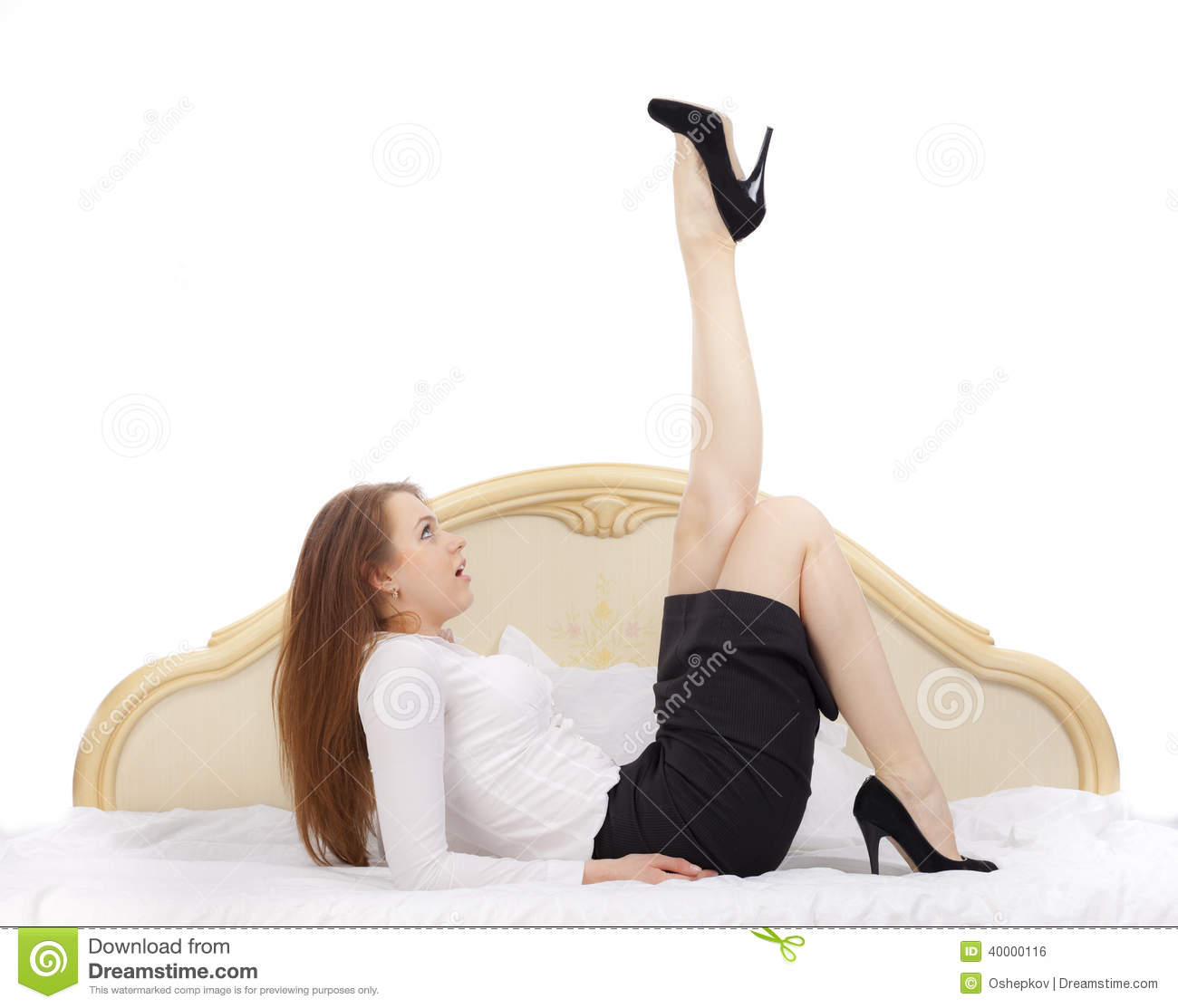 Beautiful secretary on the bed on a white background.