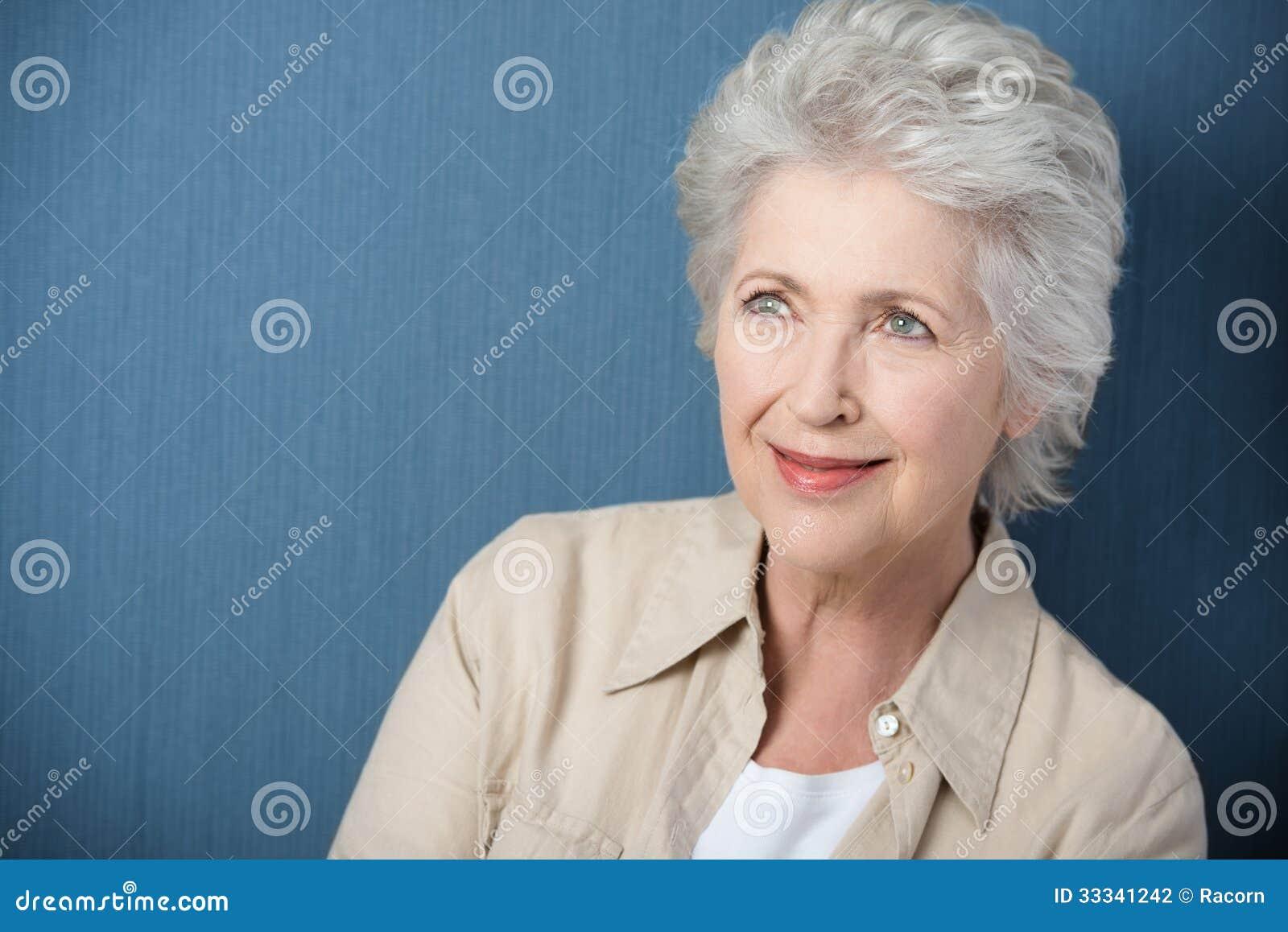 Beautiful senior woman daydreaming