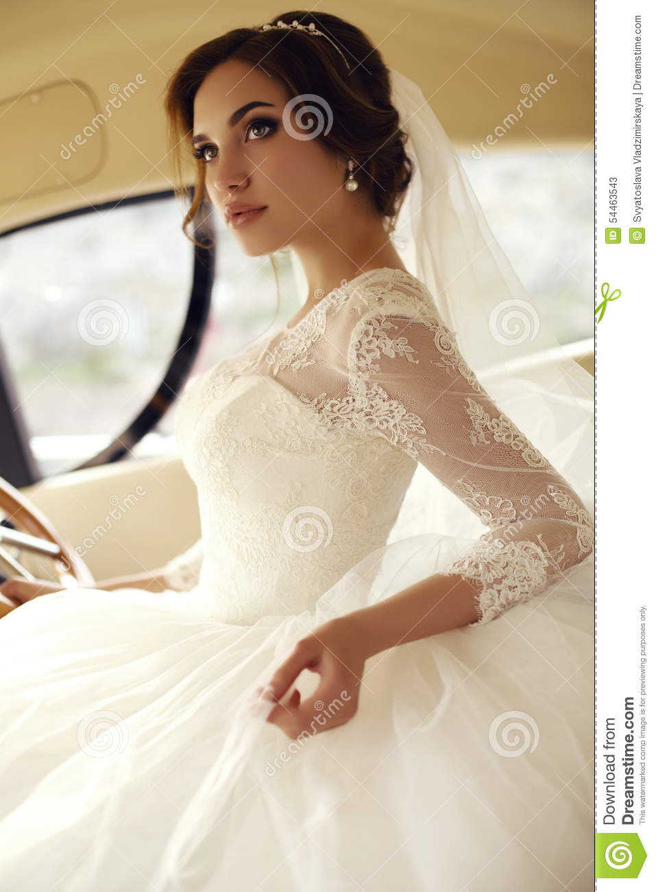 beautiful sensual bride with dark hair in luxurious lace wedding