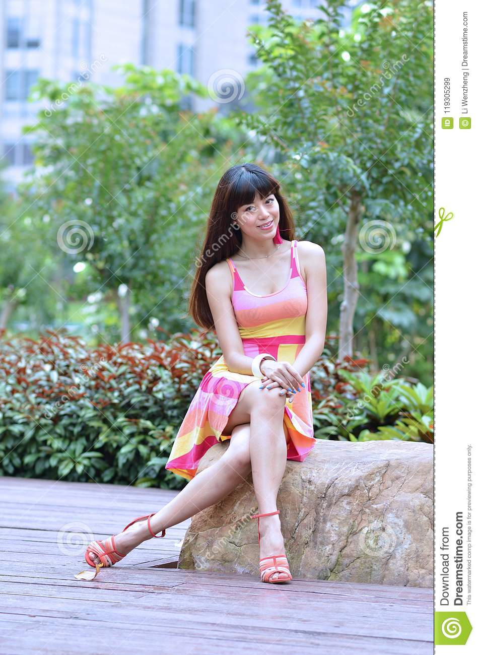 beautiful and sex asian girl shows her youth in the park stock image