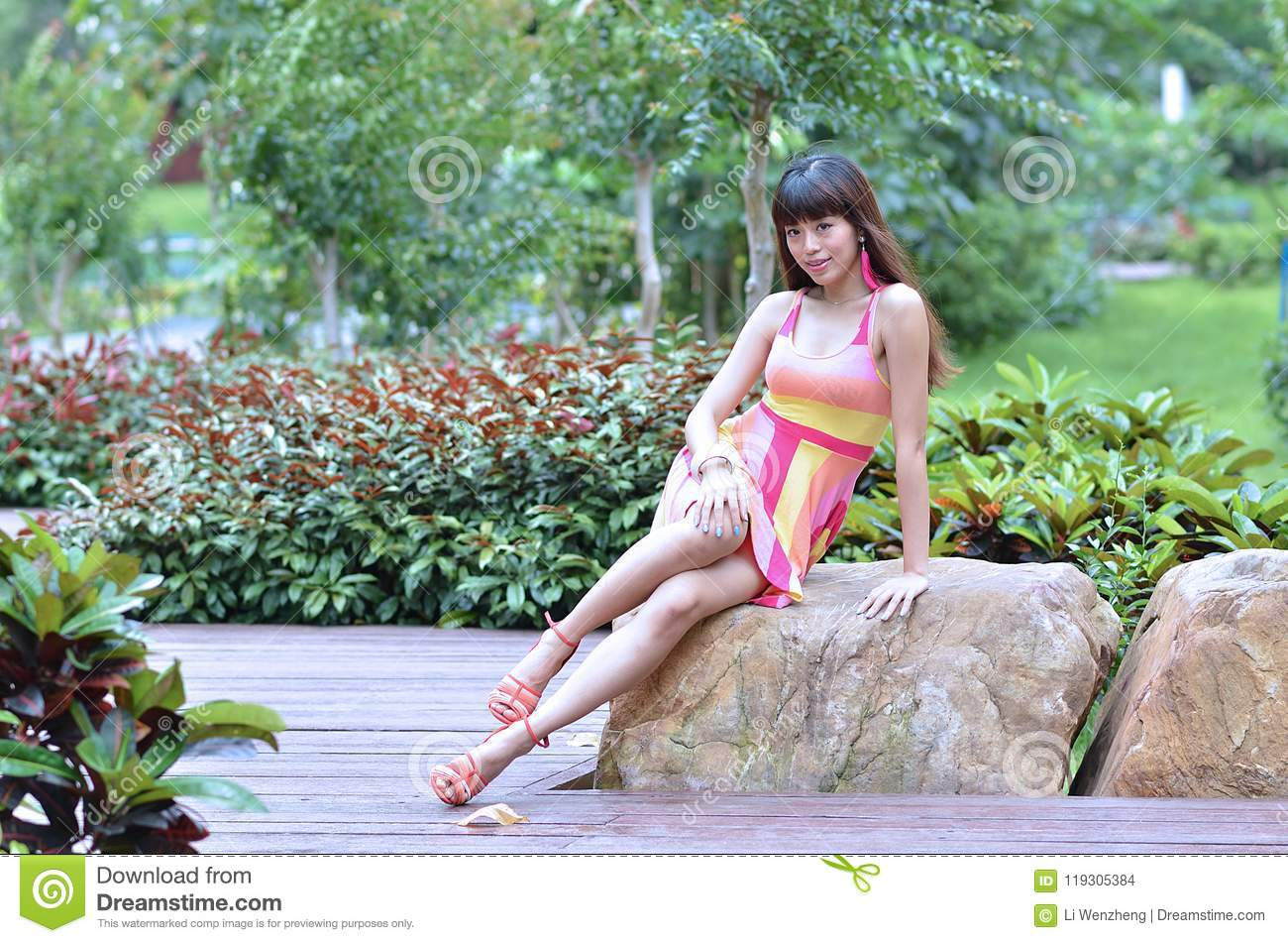 Beautiful And Sex Asian Girl Shows Her Youth In The Park Stock Photo - Image Of Park -1492