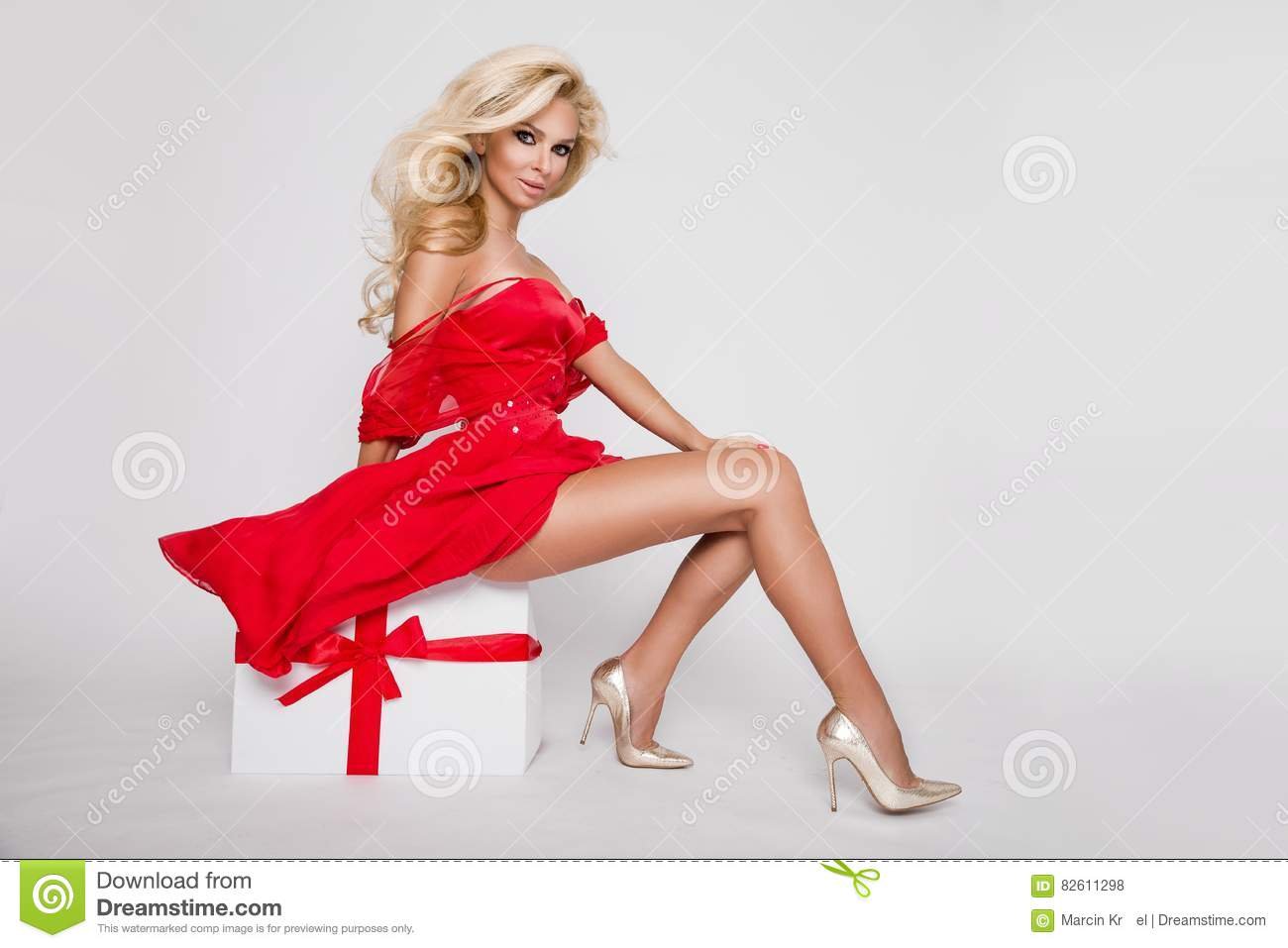 a5c673ea11b Beautiful blonde female model snowflake dressed as Santa Claus erotic red  lingerie with white fur and amazing stockings and high heels lovely makeup  sensual ...