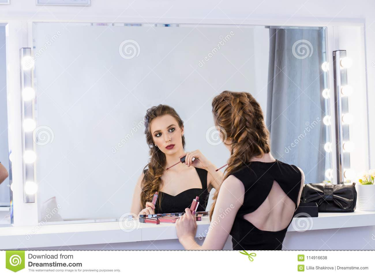 sitting on mirror Girl