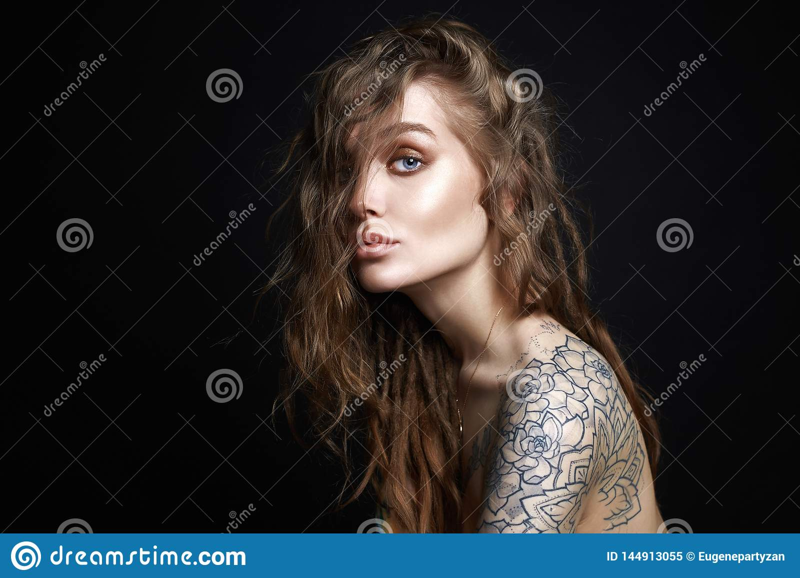 935a6d843 Sexy Young Woman with Tattoo. Fashion Portrait of Beautiful blonde Girl  with curls