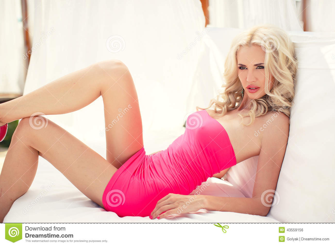 Beautiful blonde lays on the couch