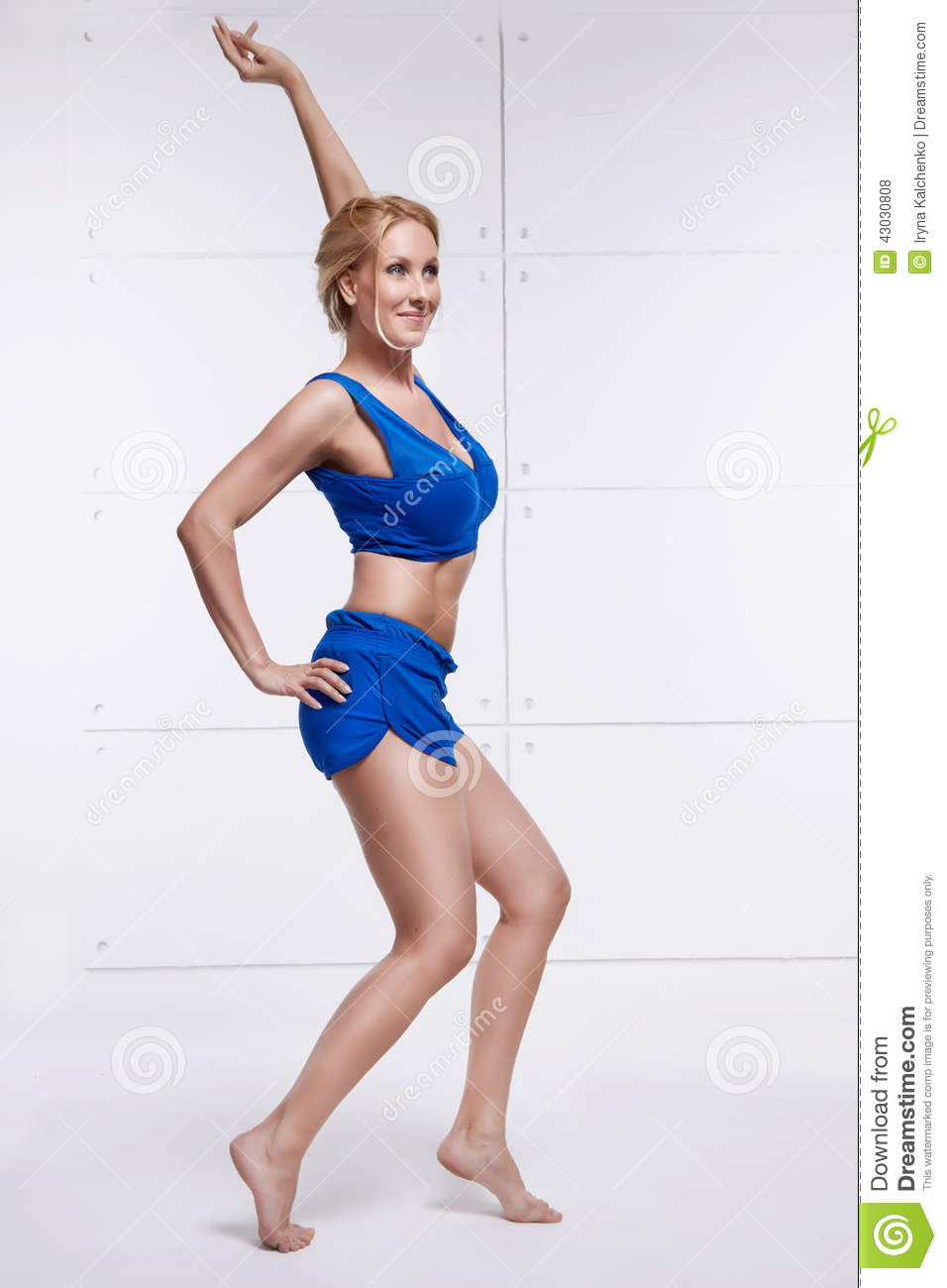 Beautiful blonde perfect athletic slim figure engaged in yoga, exercise or fitness, lead a healthy lifestyle, and eats r