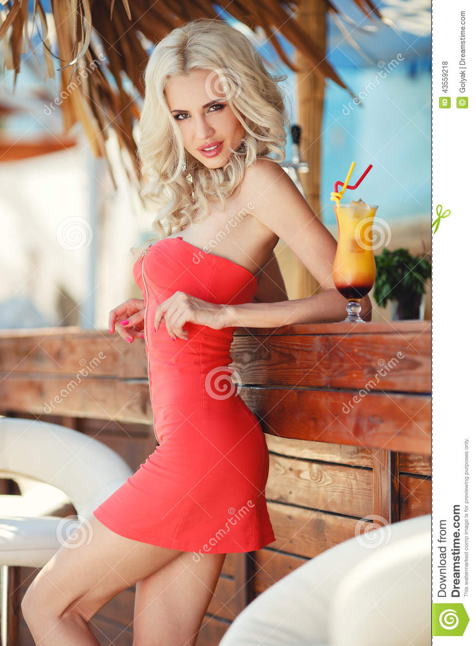 Beautiful blonde woman in bar