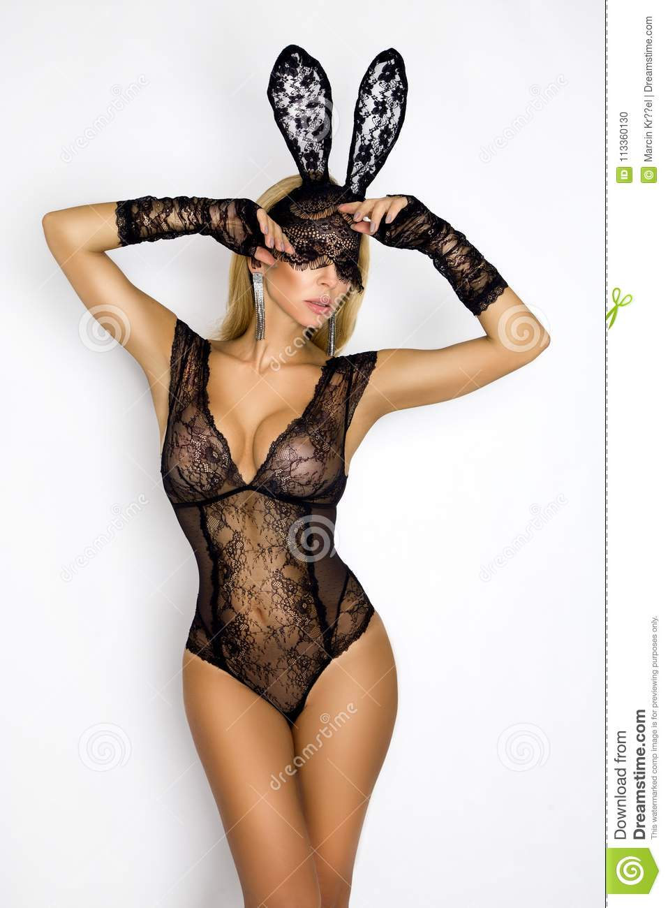 Beautiful, blonde woman in elegant lingerie and black lace Easter bunny mask