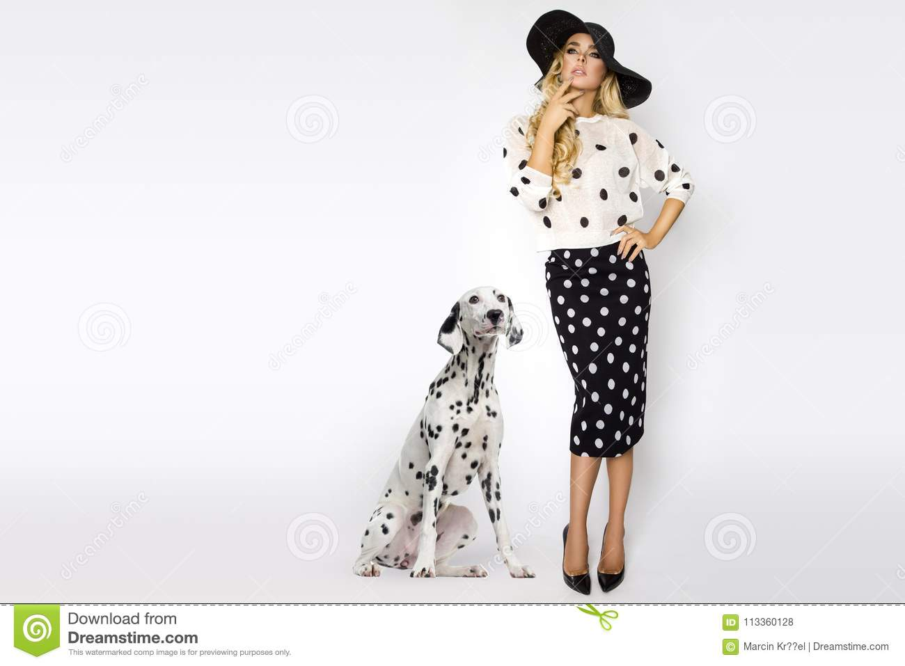 Download Beautiful, Blonde Woman In Elegant Polka Dots And A Hat, Standing On A White Background Next To A Dalmatian Dog Stock Photo - Image of dress, makeup: 113360128