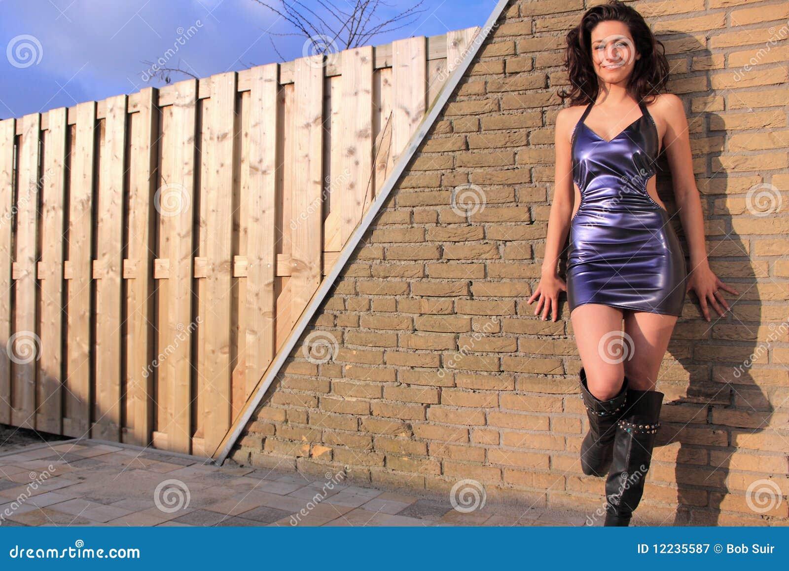 Beautiful, brunette wearing purple dress