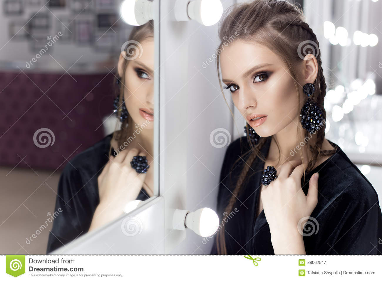 Beautiful Girl With Hair In The Style Of Rock Stands Near The Mirror ...