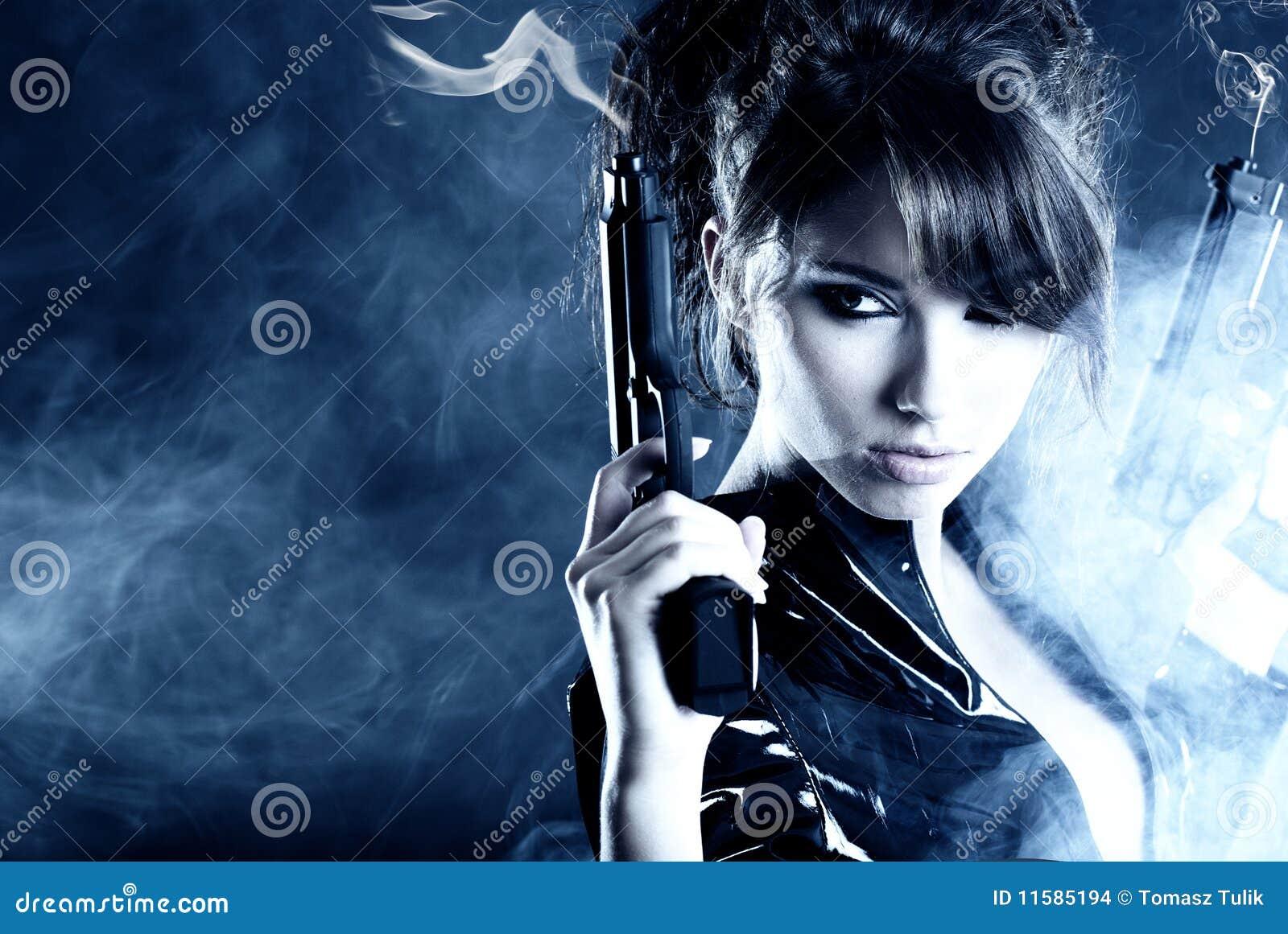 Beautiful girl holding gun