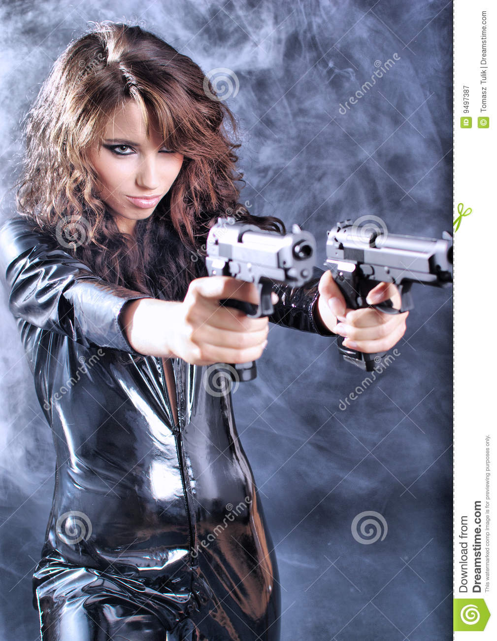 Beautiful girl holding gun