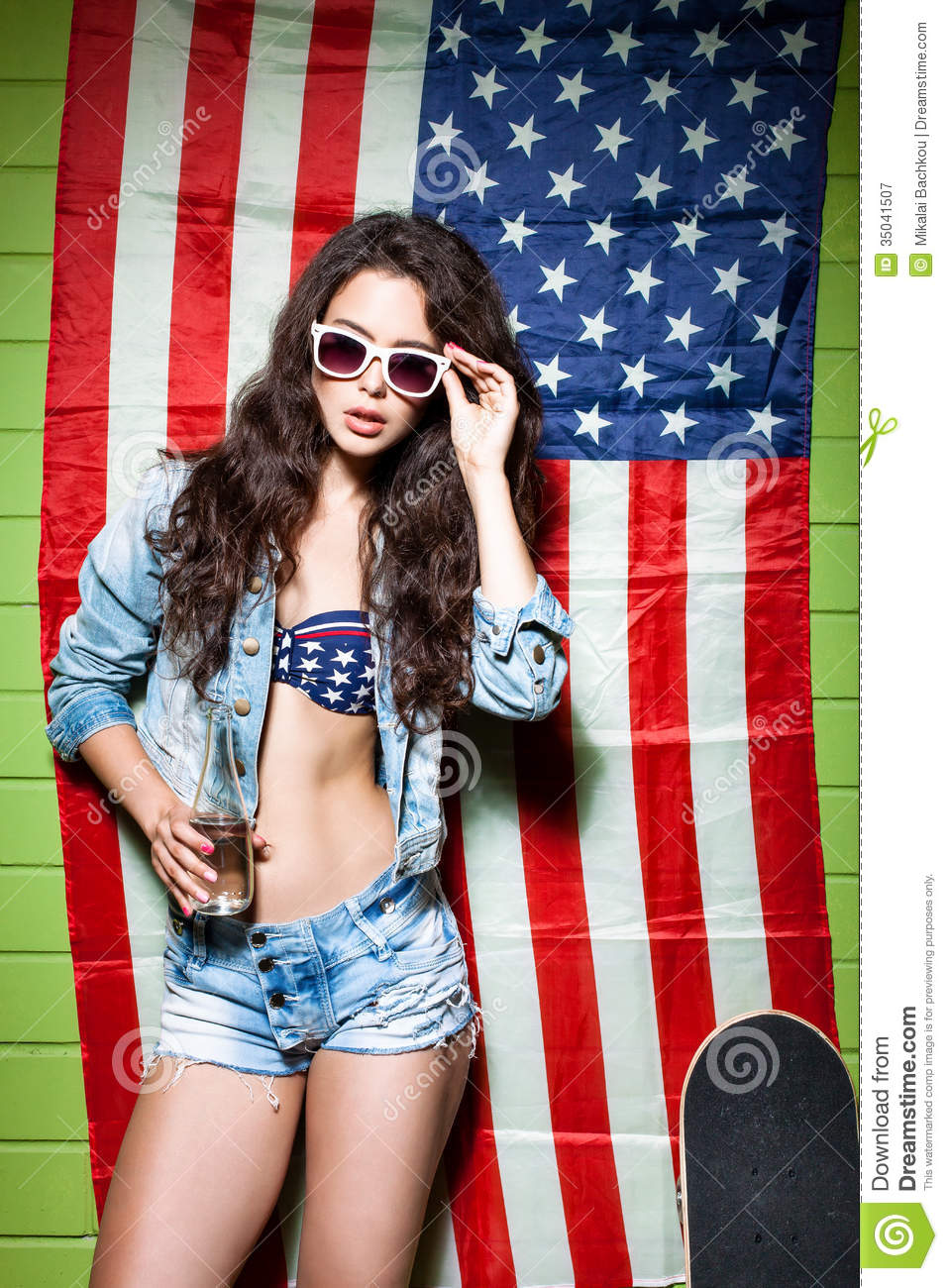 Beautiful long haired girl against american flag