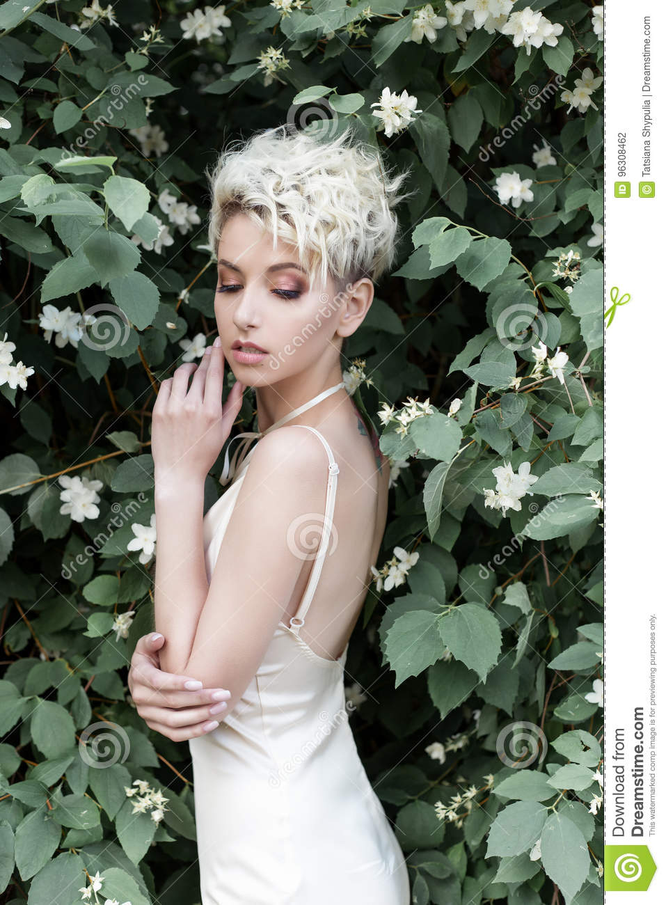 Beautiful tender girl with short haircut in cream dress with jasmine beautiful tender girl with short haircut in cream dress with jasmine flower izmirmasajfo