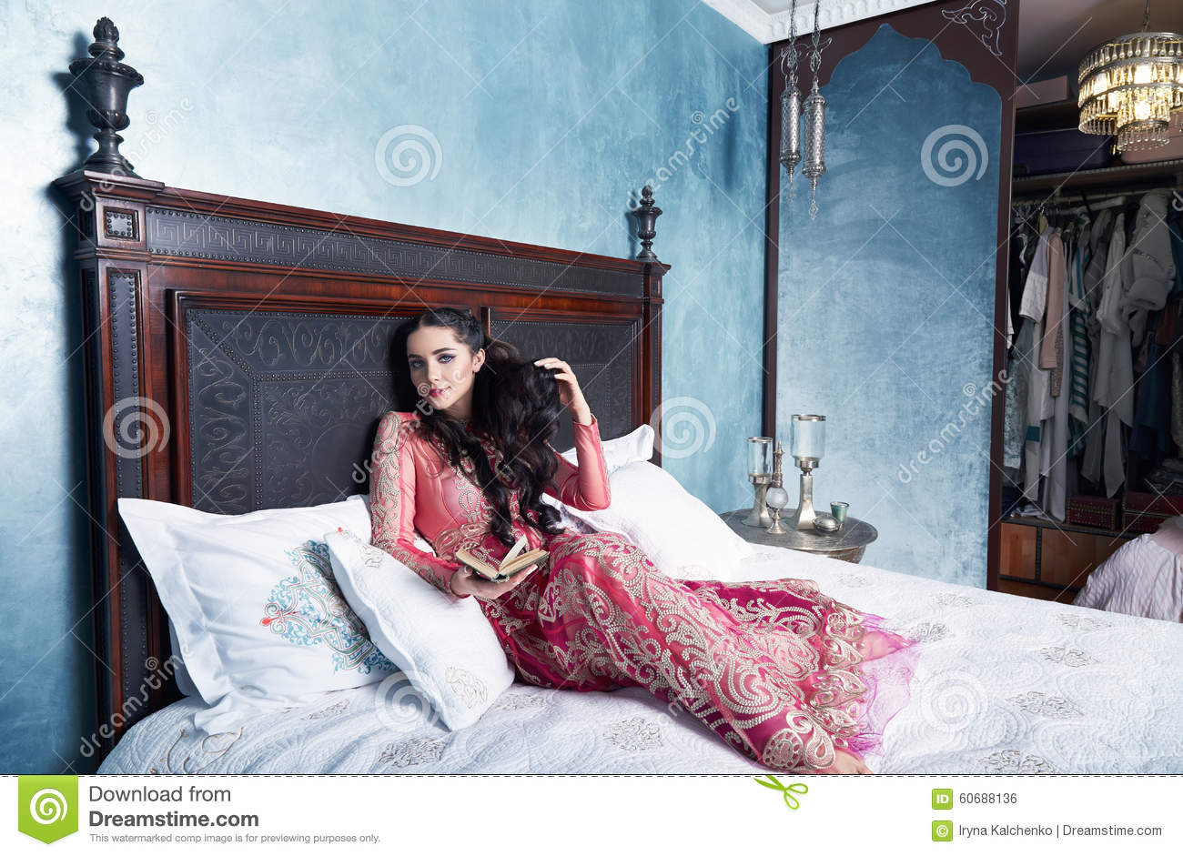 159b251ce Beautiful young woman with long dark hair brunette and decoration in  evening dress of silk lace, room bedroom in Moroccan style velvet pillows  luxurious ...