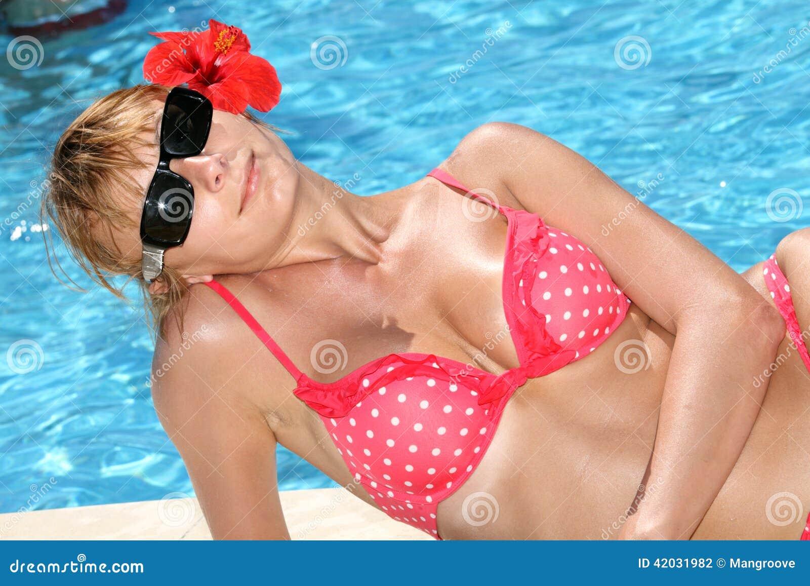 Beautiful woman in bikini at the pool