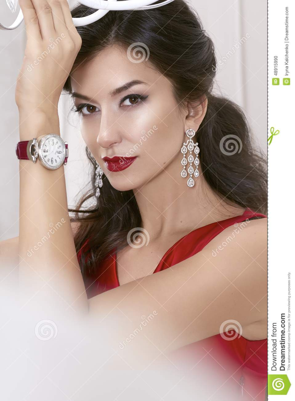 Beautiful sexy woman brunette brown eyes in a red dress in lavish