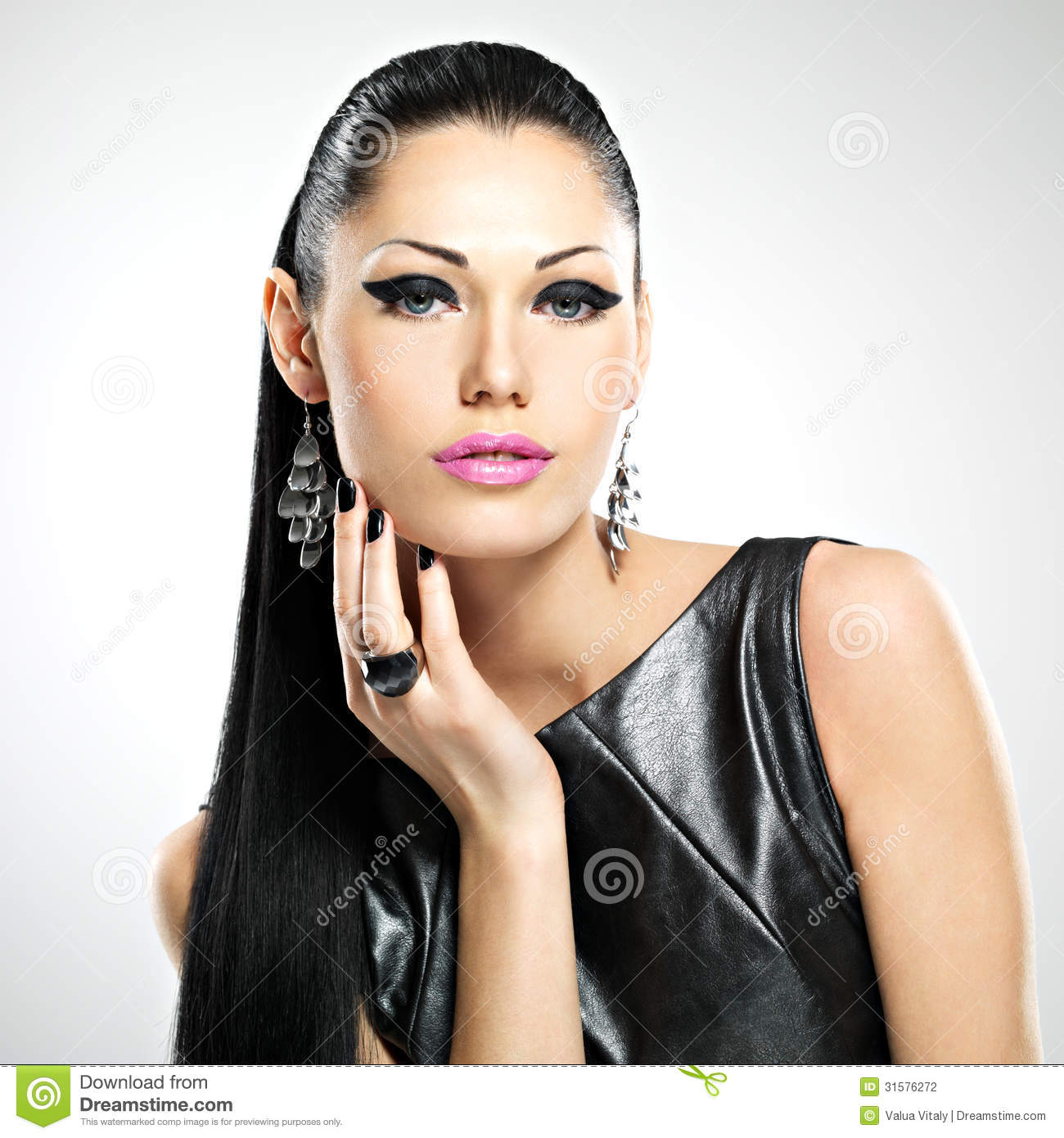 Beautiful woman with glamour fashion makeup of eyes and gl
