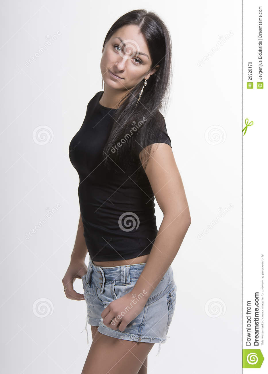 pretty young woman in denim shorts and black top stock