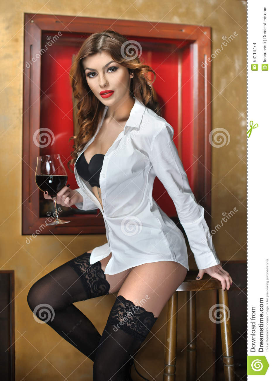 Beautiful Sexy Woman Holding A Glass Of Wine And Posing  : beautiful sexy woman holding glass wine posing provocatively portrait attractive girl wearing white male shirt over 63116774 from www.dreamstime.com size 933 x 1300 jpeg 132kB