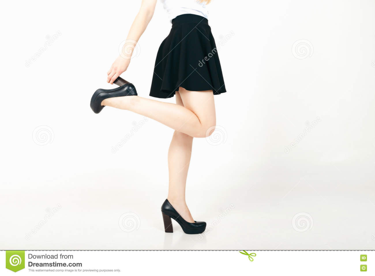 0ee34b7b7a7 woman long legs in high heels and skirt Isolated over white background.