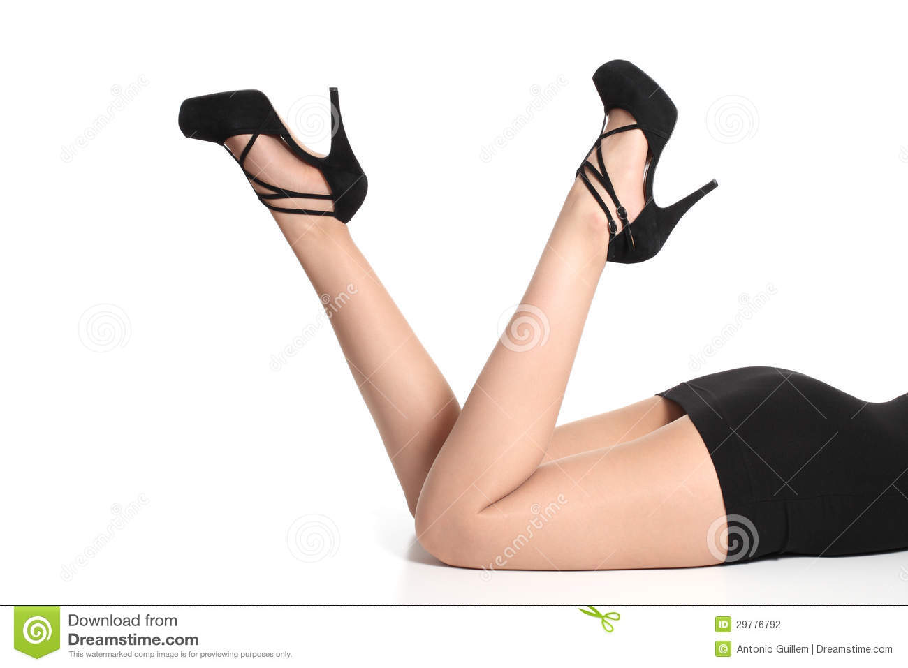 Beautiful woman legs up with heels and tights