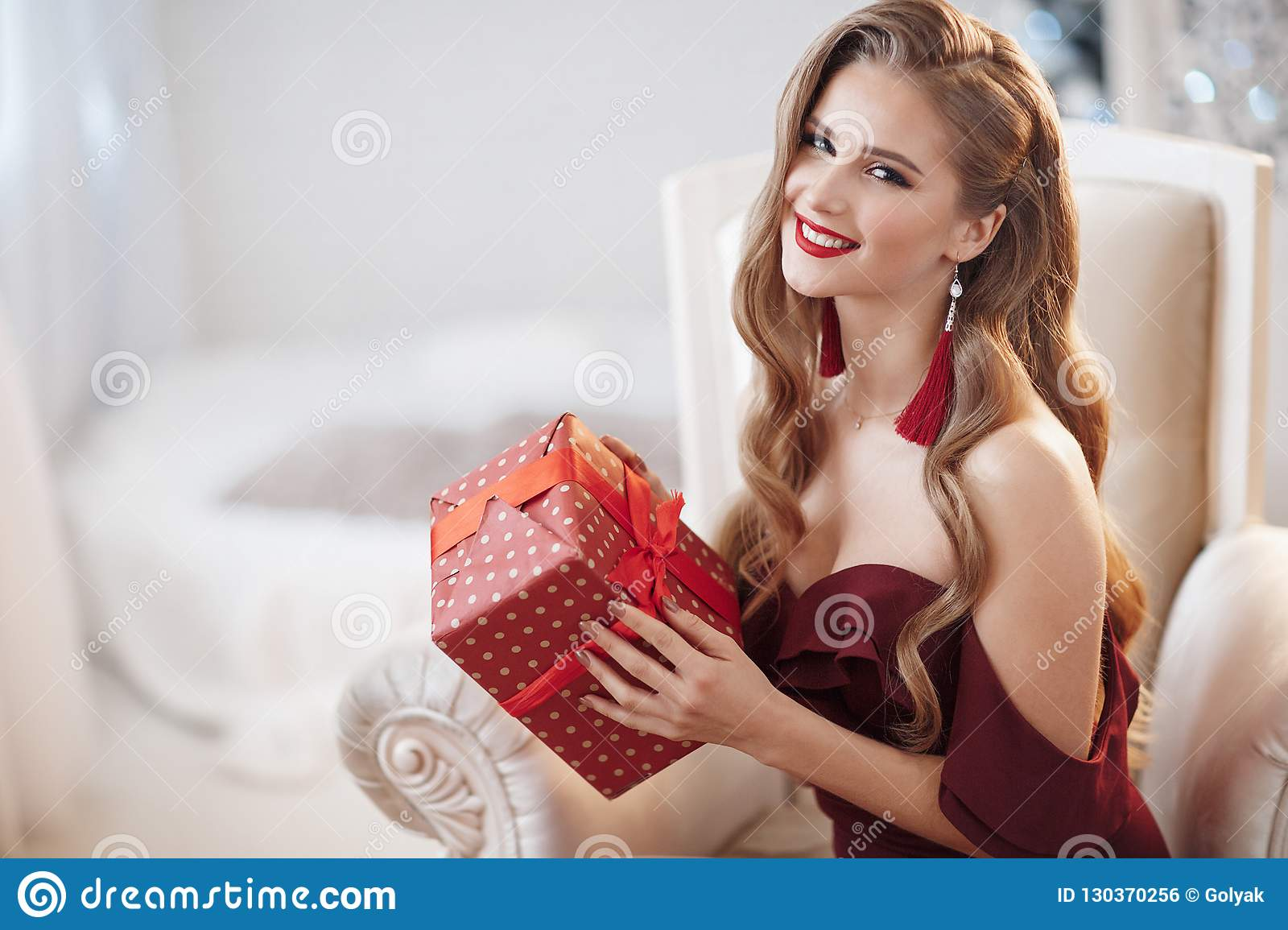 Beautiful young woman waiting for christmas at home