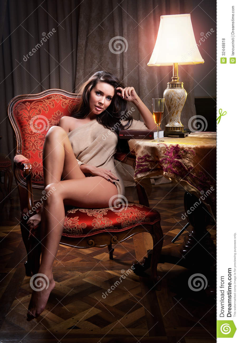 Charming hot girl sitting in chair