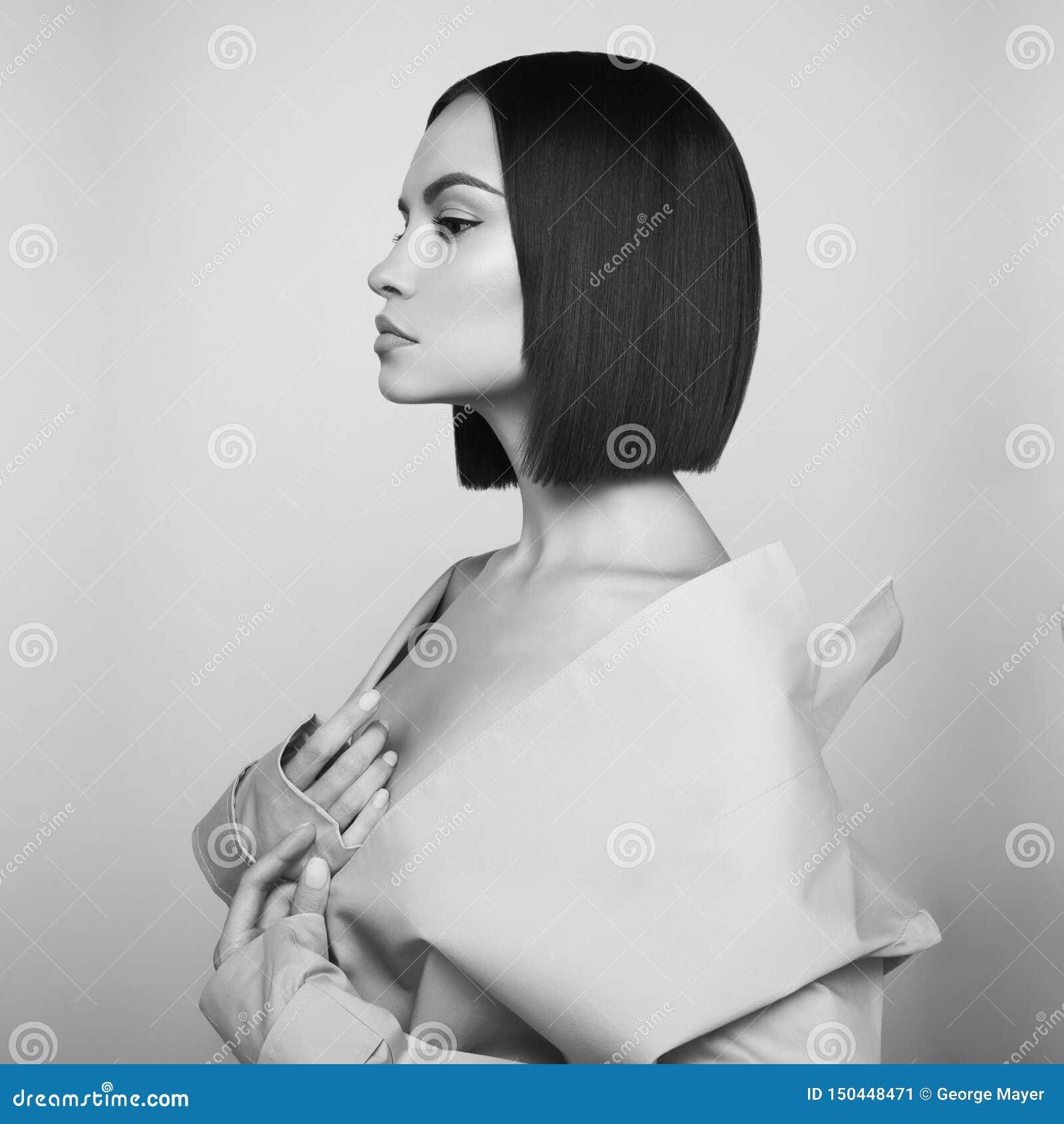 Beautiful woman in white autumn coat. Fashion art portrait