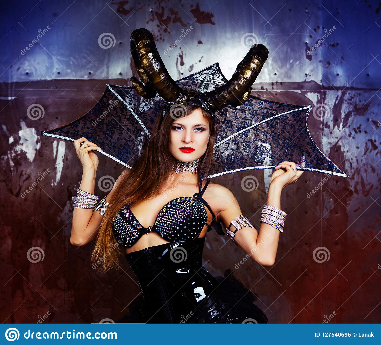 Model Wearing Halloween Costume Of Leather And Horns Stock