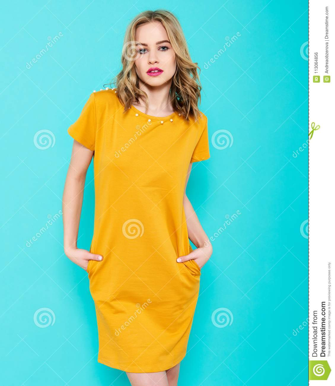 Beautiful Young Woman In Bright Yellow Party Dress Studio Portrait ...