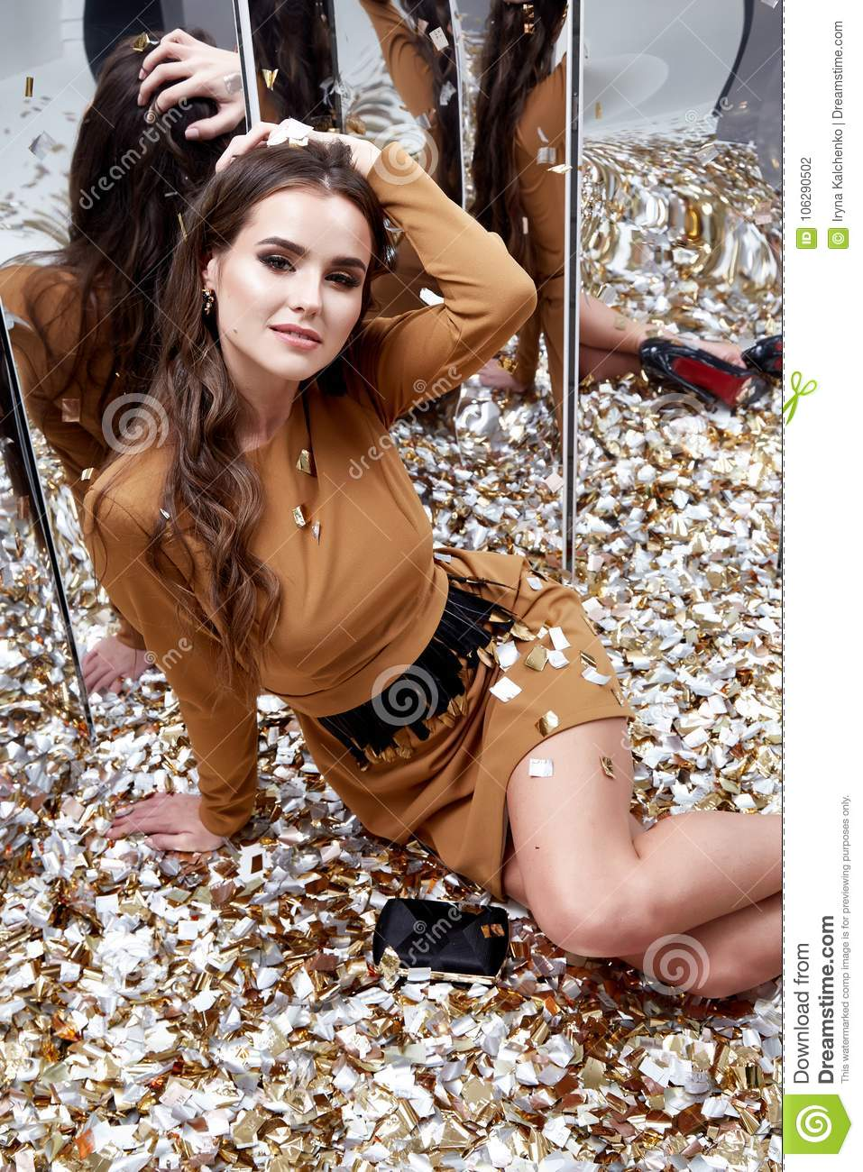 222a742cc9 Beautiful Young Woman Sit Floor With Lot Of Golden Sequins Stock ...
